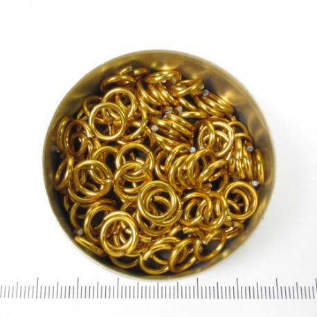 Shiny goldtoned aluminium, 1.6x6.6 mm, 100 saw-cut rings